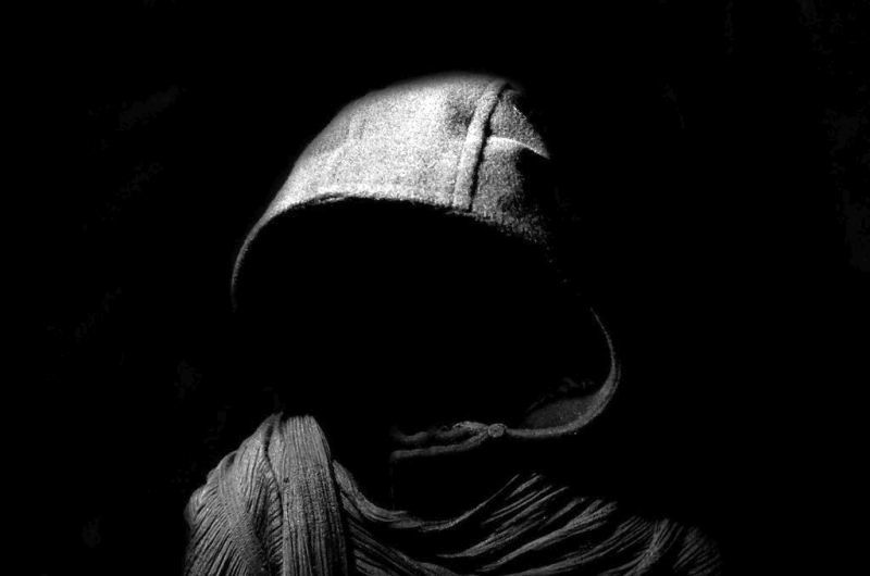 Silhouette of man with hoodie