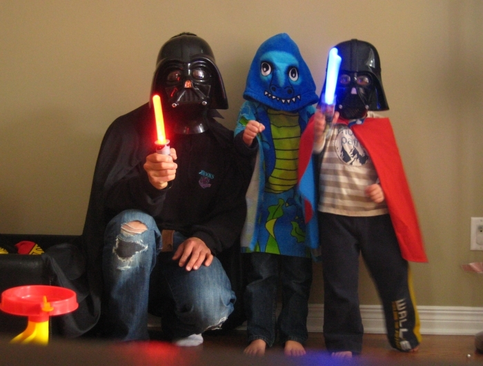 Dad and kids in costumes