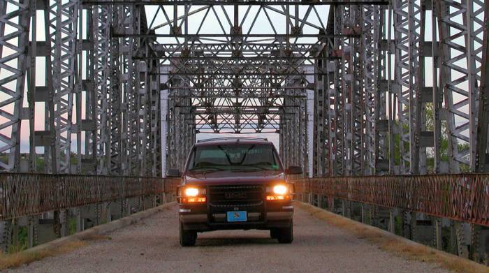 GMC truck on bridge