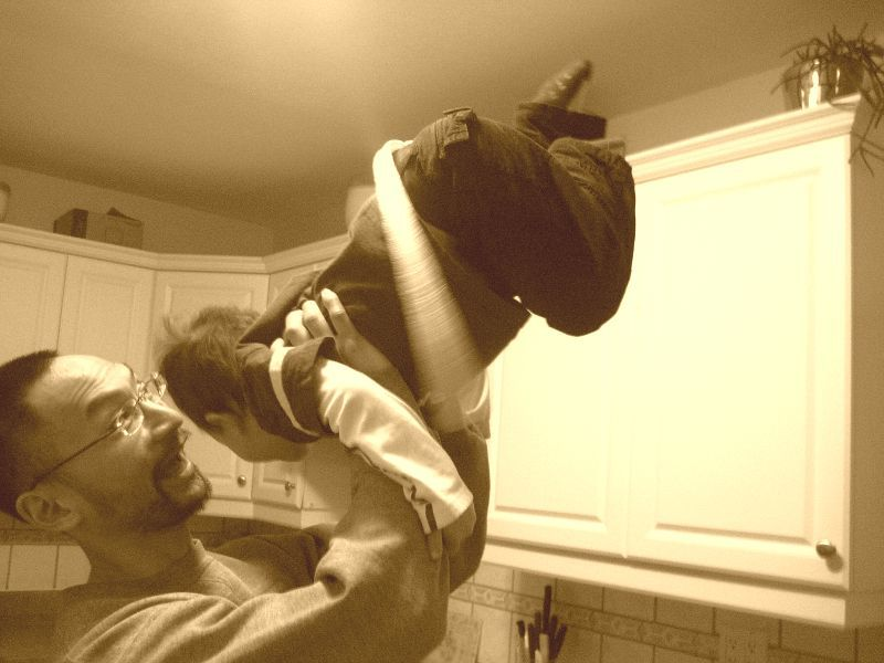 Dad lifting son