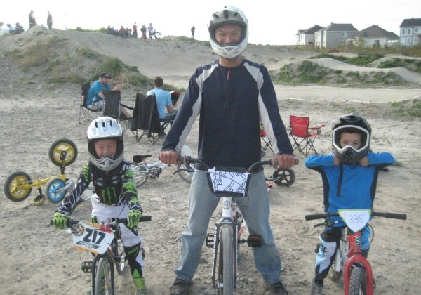 Dad and boys at BMX park