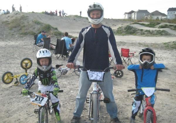 Dad and boys at BMX park